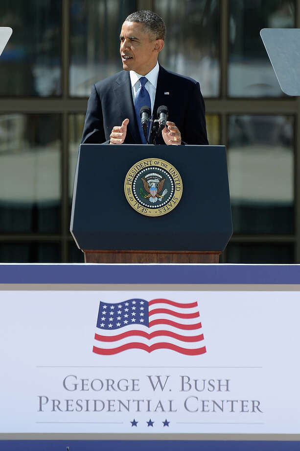 U.S. President Barack Obama speaks during the opening ceremony of the George W. Bush Presidential Center April 25, 2013 in Dallas, Texas. The Bush library, which is located on the campus of Southern Methodist University, with more than 70 million pages of paper records, 43,000 artifacts, 200 million emails and four million digital photographs, will be opened to the public on May 1, 2013. The library is the 13th presidential library in the National Archives and Records Administration system. Photo: Kevork Djansezian, Getty Images / 2013 Getty Images