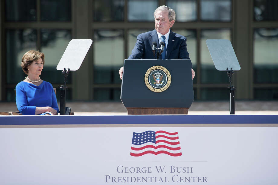 Former First Lady Laura Bush listens while former US President George W. Bush speaks during a dedication ceremony at the George W. Bush Library and Museum on the grounds of Southern Methodist University April 25, 2013 in Dallas, Texas. The Bush library is dedicated to chronicling the presidency of the United State's 43rd President, George W. Bush. Photo: BRENDAN SMIALOWSKI, AFP/Getty Images / 2013 AFP