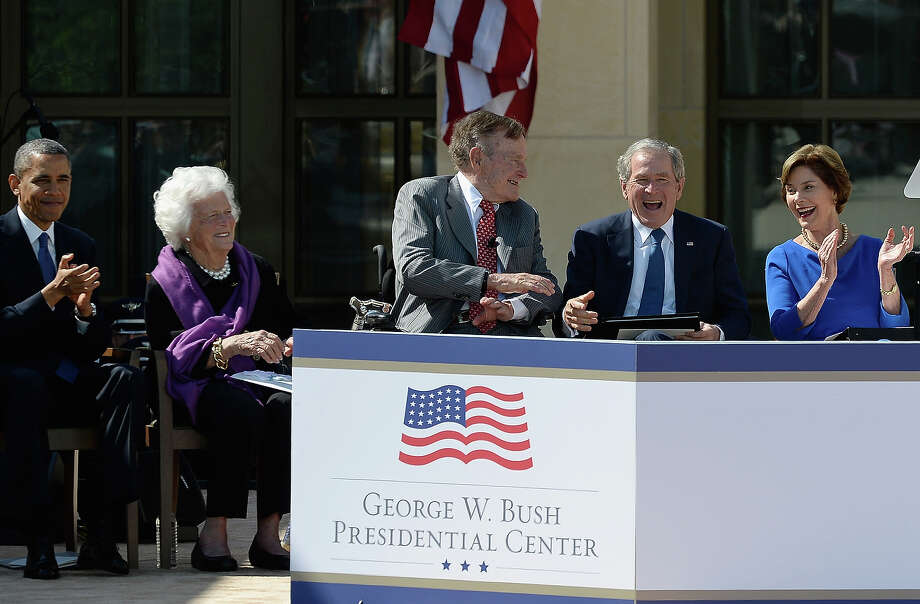 (L-R) U.S. President Barack Obama, former first lady Barbara Bush, former President George H.W. Bush, former President George W. Bush and former first lady Laura Bush attend the opening ceremony of the George W. Bush Presidential Center April 25, 2013 in Dallas, Texas. The Bush library, which is located on the campus of Southern Methodist University, with more than 70 million pages of paper records, 43,000 artifacts, 200 million emails and four million digital photographs, will be opened to the public on May 1, 2013. The library is the 13th presidential library in the National Archives and Records Administration system. Photo: Kevork Djansezian, Getty Images / 2013 Getty Images