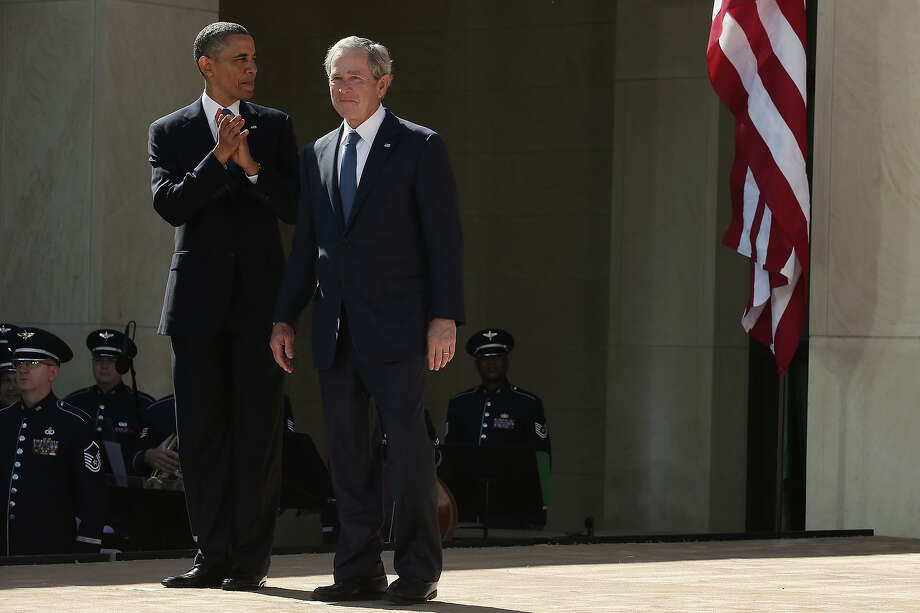 U.S. President Barack Obama (L) and former President George W. Bush attend the opening ceremony of the George W. Bush Presidential Center April 25, 2013 in Dallas, Texas. The Bush library, which is located on the campus of Southern Methodist University, with more than 70 million pages of paper records, 43,000 artifacts, 200 million emails and four million digital photographs, will be opened to the public on May 1, 2013. The library is the 13th presidential library in the National Archives and Records Administration system. Photo: Alex Wong, Getty Images / 2013 Getty Images