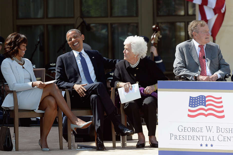 (L-R) First lady Michelle Obama, U.S. President Barack Obama, former first lady Barbara Bush and former President George H.W. Bush attend the opening ceremony of the George W. Bush Presidential Center April 25, 2013 in Dallas, Texas. The Bush library, which is located on the campus of Southern Methodist University, with more than 70 million pages of paper records, 43,000 artifacts, 200 million emails and four million digital photographs, will be opened to the public on May 1, 2013. The library is the 13th presidential library in the National Archives and Records Administration system. Photo: Kevork Djansezian, Getty Images / 2013 Getty Images
