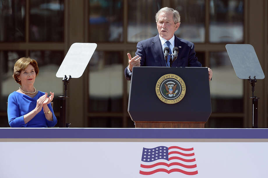 Former President George W. Bush (R) speaks as former first lady Laura Bush applauds during the opening ceremony of the George W. Bush Presidential Center April 25, 2013 in Dallas, Texas. The Bush library, which is located on the campus of Southern Methodist University, with more than 70 million pages of paper records, 43,000 artifacts, 200 million emails and four million digital photographs, will be opened to the public on May 1, 2013. The library is the 13th presidential library in the National Archives and Records Administration system. Photo: Kevork Djansezian, Getty Images / 2013 Getty Images