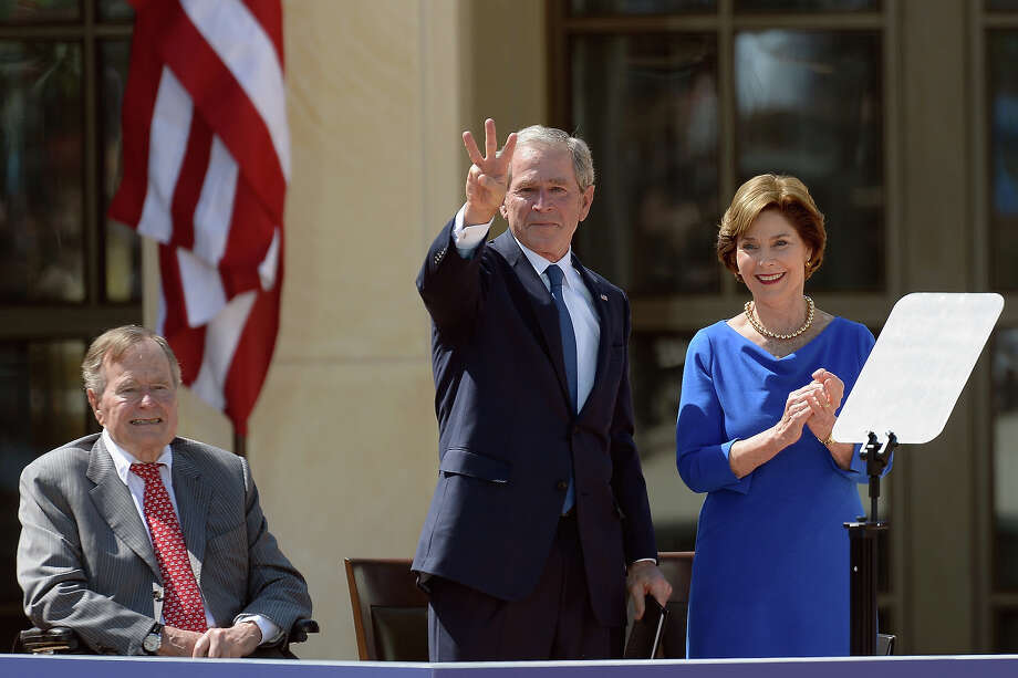 (L-R) Former President George H.W. Bush, former President George W. Bush and former first lady Laura Bush attend the opening ceremony of the George W. Bush Presidential Center April 25, 2013 in Dallas, Texas. The Bush library, which is located on the campus of Southern Methodist University, with more than 70 million pages of paper records, 43,000 artifacts, 200 million emails and four million digital photographs, will be opened to the public on May 1, 2013. The library is the 13th presidential library in the National Archives and Records Administration system. Photo: Kevork Djansezian, Getty Images / 2013 Getty Images