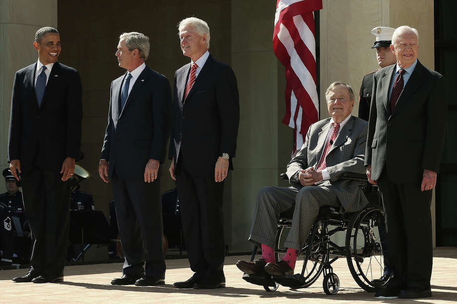 (L-R) U.S. President Barack Obama, former President George W. Bush, former President Bill Clinton, former President George H.W. Bush and former President Jimmy Carter attend the opening ceremony of the George W. Bush Presidential Center April 25, 2013 in Dallas, Texas. The Bush library, which is located on the campus of Southern Methodist University, with more than 70 million pages of paper records, 43,000 artifacts, 200 million emails and four million digital photographs, will be opened to the public on May 1, 2013. The library is the 13th presidential library in the National Archives and Records Administration system. Photo: Alex Wong, Getty Images / 2013 Getty Images
