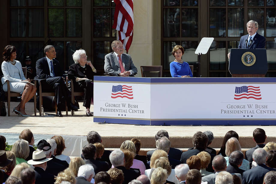 Former President George W. Bush (R) speaks as (L-R) first lady Michelle Obama, U.S. President Barack Obama, former first lady Barbara Bush, former President George H.W. Bush and former first lady Laura Bush attend the opening ceremony of the George W. Bush Presidential Center April 25, 2013 in Dallas, Texas. The Bush library, which is located on the campus of Southern Methodist University, with more than 70 million pages of paper records, 43,000 artifacts, 200 million emails and four million digital photographs, will be opened to the public on May 1, 2013. The library is the 13th presidential library in the National Archives and Records Administration system. Photo: Kevork Djansezian, Getty Images / 2013 Getty Images