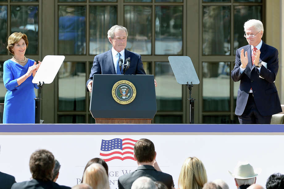 Former President George W. Bush (C) speaks as former first lady Laura Bush (L) and former President Bill Clinton applaud during the opening ceremony of the George W. Bush Presidential Center April 25, 2013 in Dallas, Texas. The Bush library, which is located on the campus of Southern Methodist University, with more than 70 million pages of paper records, 43,000 artifacts, 200 million emails and four million digital photographs, will be opened to the public on May 1, 2013. The library is the 13th presidential library in the National Archives and Records Administration system. Photo: Kevork Djansezian, Getty Images / 2013 Getty Images