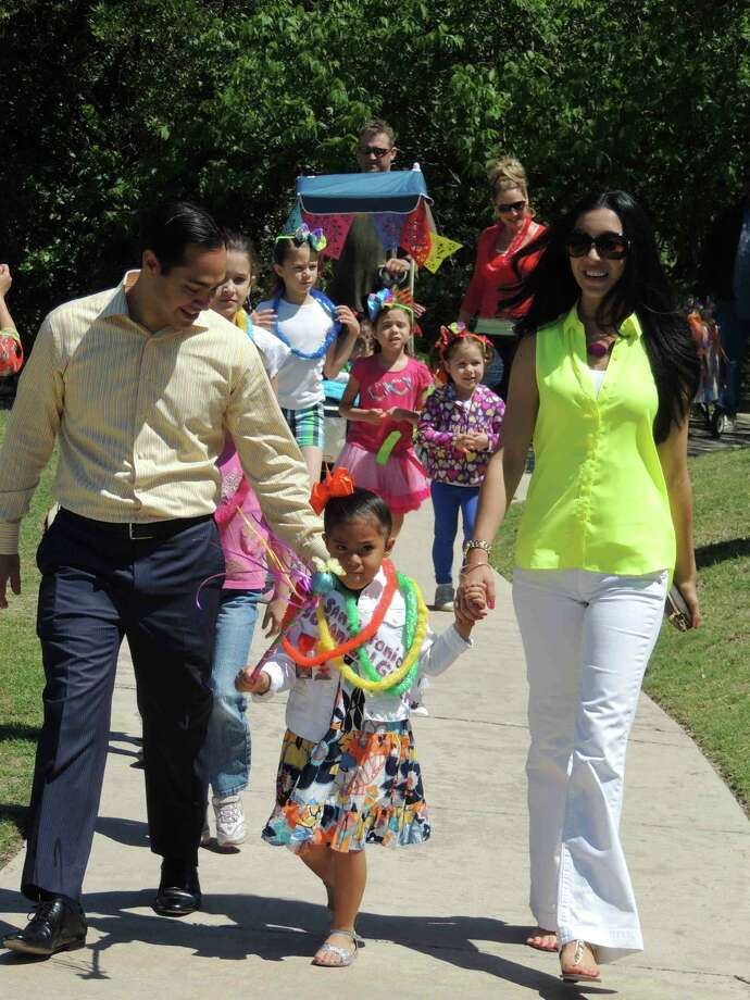 San Antonio Mayor Julian Castro and his wife Erica accompany their 4-year-old daughter Carina at the children's parade during Viva Botanica last week at the San Antonio Botanical Garden. Carina was the parade marshal. Photo: Courtesy Photo