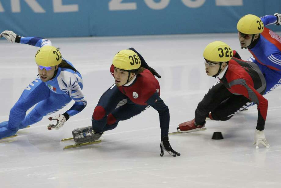 Apolo Ohno of the USA competes in the men's 1500m speed skating final during the Salt Lake City Winter Olympic Games on Feb. 20, 2002 at the Salt Lake Ice Center in Salt Lake City, Utah. Photo: Mike Powell, Getty Images / 2002 Getty Images