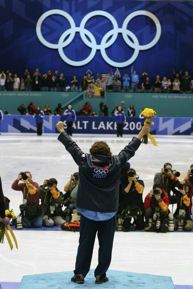 Apolo Ohno celebrates winning the gold medal in the men's 1500m speed skating final during the Salt Lake City Winter Olympic Games on Feb. 20, 2002 at the Salt Lake Ice Center in Salt Lake City, Utah. Photo: Jamie Squire, Getty Images / 2002 Getty Images
