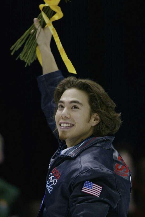 Apolo Anton Ohno of the USA receives the gold medal for the men's 1500m speed skating final during the Salt Lake City Winter Olympic Games on Feb. 20, 2002 at the Salt Lake Ice Center in Salt Lake City, Utah. Photo: Adam Pretty, Getty Images / 2002 Getty Images