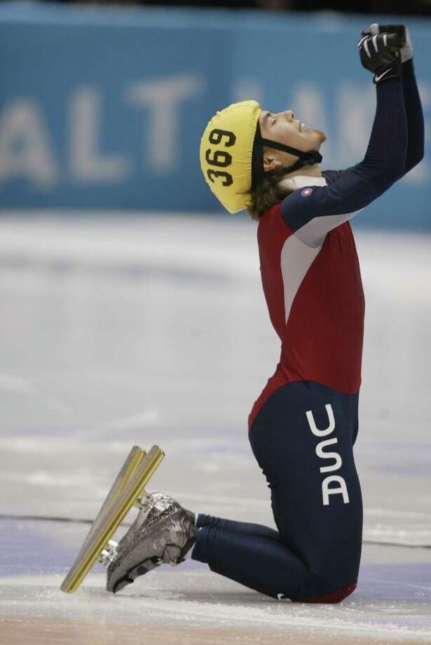 Apolo Anton Ohno of the USA celebrates winning the gold medal in the men's 1500m speed skating final during the Salt Lake City Winter Olympic Games on Feb. 20, 2002 at the Salt Lake Ice Center in Salt Lake City, Utah. Photo: Adam Pretty, Getty Images / 2002 Getty Images