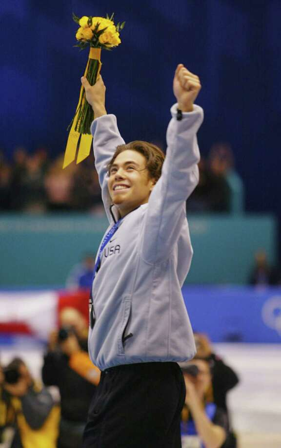 Apolo Anton Ohno of the USA celebrates before receiving the silver medal in the men's 1000m speed skating during the Salt Lake City Winter Olympic Games at the Salt Lake Ice Center in Salt Lake City, Utah. Photo: Mike Hewitt, Getty Images / Getty Images North America