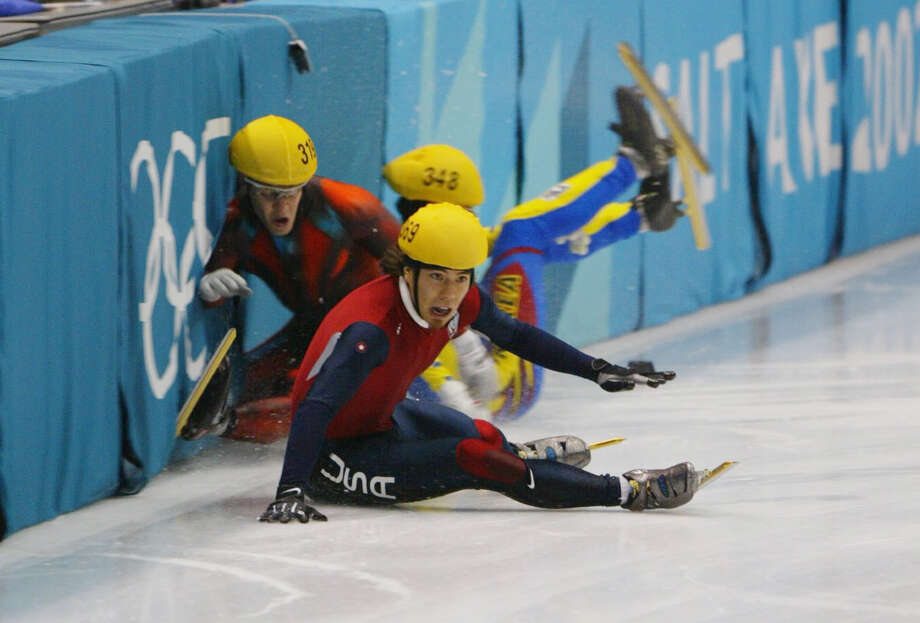 Mathieu Turcott of Canada, Apolo Anton Ohno and Hyun-Soo Ahn of Korea all crash into the boards on the last lap of the men's 1000m speed skating final during the Salt Lake City Winter Olympic Games at the Salt Lake Ice Center in Salt Lake City, Utah. Steven Bradbury of Australia (not pictured) crossed the finish line first to win the gold medal. Photo: Mike Hewitt, Getty Images / Getty Images North America