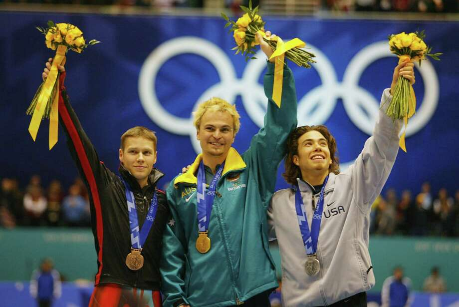 Mathieu Turcotte, bronze, of Canada, Steven Bradbury, gold, of the Australia and Apolo Anton Ohno, silver, receive their medals for the men's 1000m speed skating during the Salt Lake City Winter Olympic Games at the Salt Lake Ice Center in Salt Lake City, Utah. DIGITAL IMAGE. Photo: Mike Hewitt, Getty Images / Getty Images North America