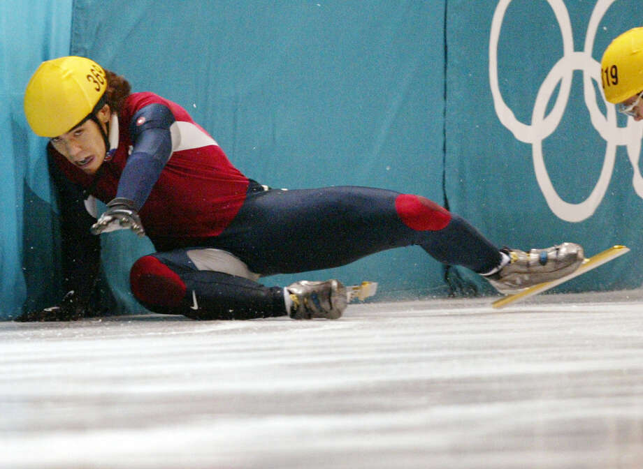 Apolo Anton Ohno and Canadian Mathieu Turcotte (R) crush into the bareer during the men's 1000m final short track race at the Olympic Ice Center, 16  Feb. 2002 during the XIXth Winter Olympics in Salt Lake City. Photo: JACQUES DEMARTHON, Getty Images / AFP