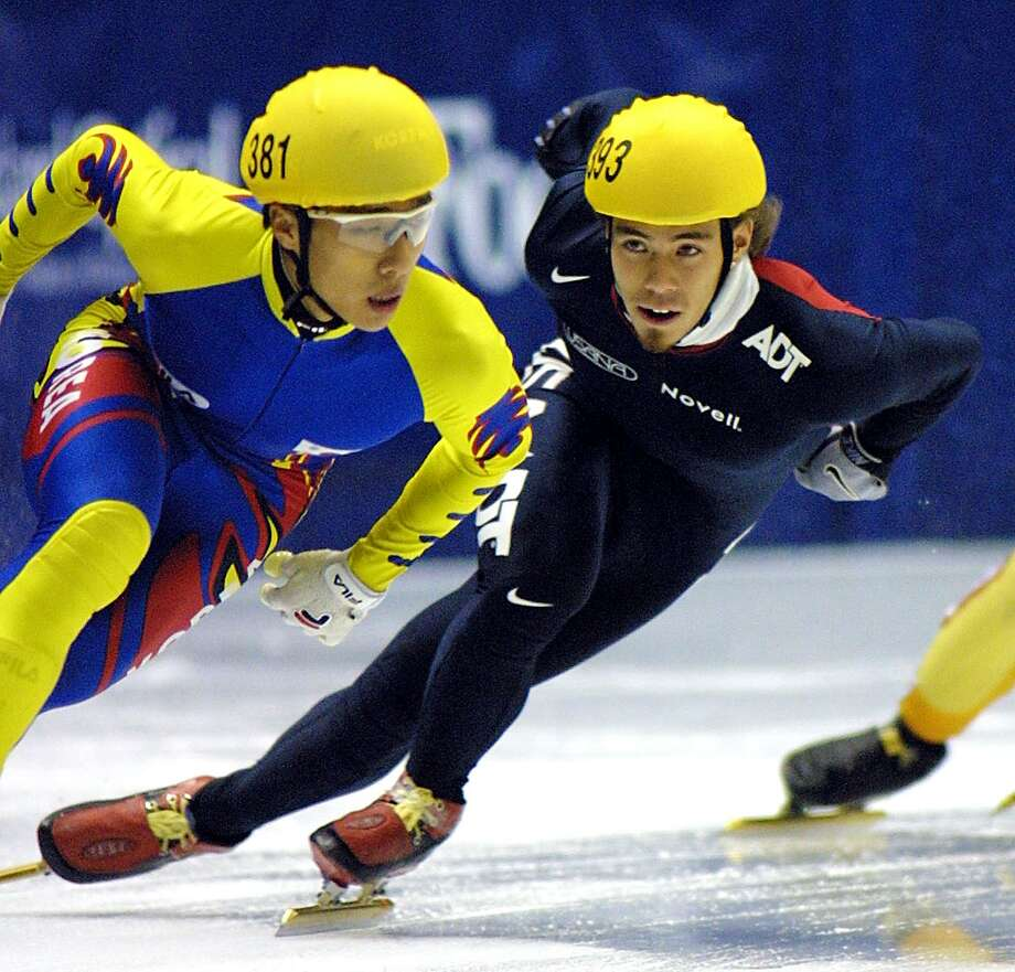 Apolo Anton Ohno chases down Doung-Sung Kim (L) from Korea during the finals of the men's 3000m relay at the 2002 Short Track Speed Skating Olympic Qualifying Competition at the  Delta Center in Salt Lake City, Utah on Oct. 28, 2001. Photo: GEORGE FREY, Getty Images / AFP