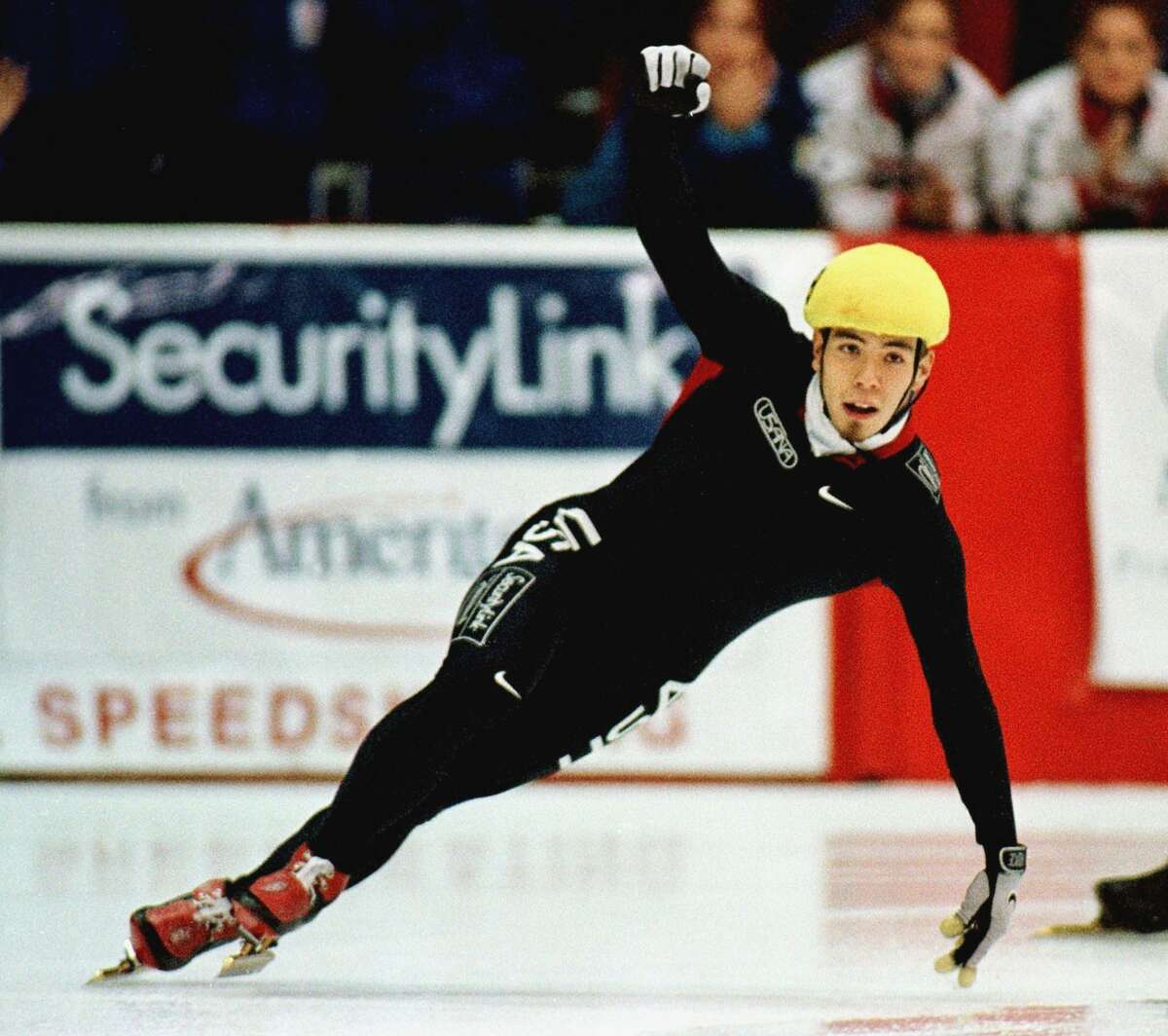 Apolo Anton Ohno from the USA celebrates after winning the men's 500 meter finals race at the 2000 short track speed skating World Cup Championships in Provo, Utah.