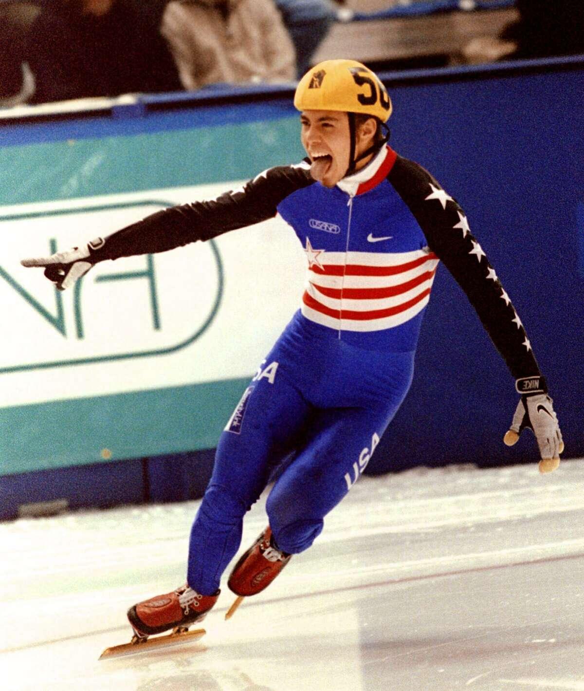 Apolo Anton Ohno of the US celebrates winning the men's 500-meter World Cup short track speedskating event Oct. 21, 2000 in Calgary, Alberta.