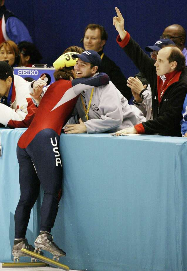 Apolo Anton Ohno of the US is congratulated by a team member at the end of the men's 1500m Final of the short track speed skating at the Olympic Ice Center, on Feb. 20, 2002 during the XIXth Winter Olympic Games in Salt Lake City. Photo: JACQUES DEMARTHON, Getty Images / AFP