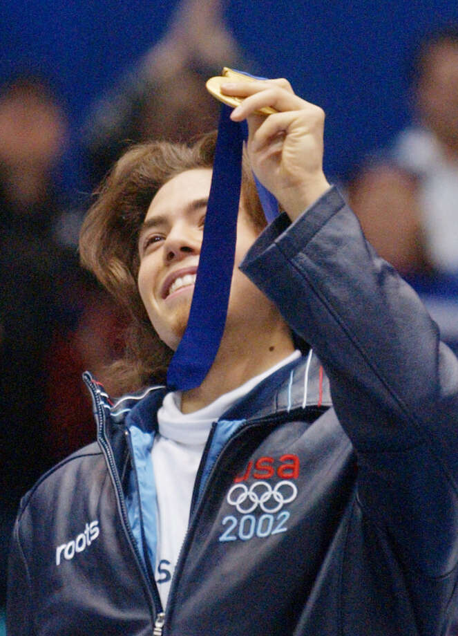 Apolo Anton Ohno of the US jubilates on the podium after winning the mens 1500m short track finals at the Olympic Ice Center on Feb. 20, 2002. Photo: JOHN MACDOUGALL, Getty Images / AFP