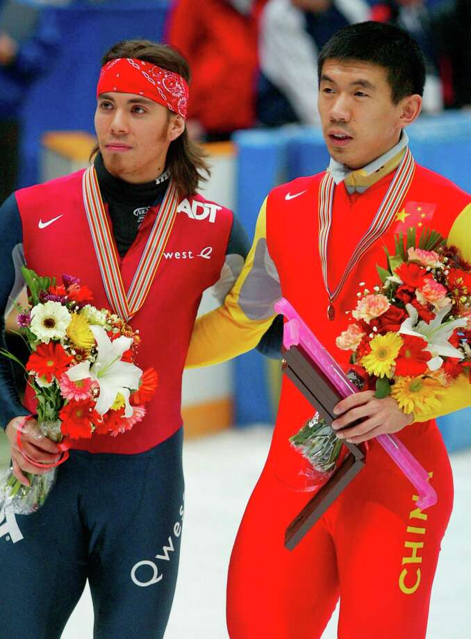 Apolo Anton and Li Jiajun of China celebrate after the final competition of the Men's 1,000 meter at the World Short Track Speed Skating Championship on March 13, 2005 in Beijing, China. Photo: China Photos, Getty Images / 2005 China Photos