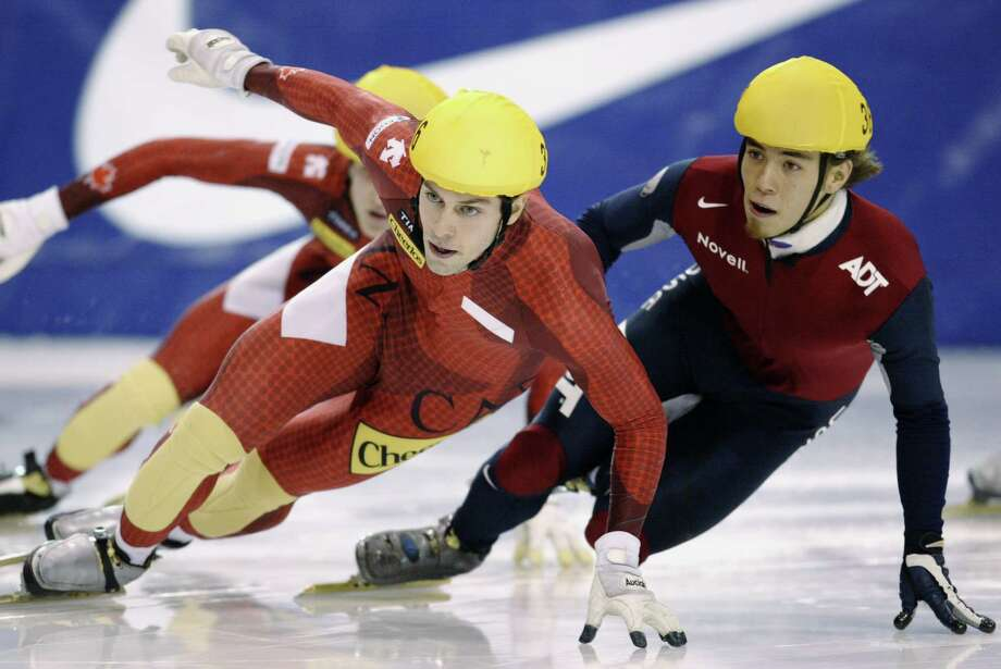 Jean-Francois Monette of Canada keeps Apolo Anton Ohno at bay  during the men's 500 meter finals of the ISU Short Track Speedskating World Cup Feb. 8, 2003, at the Utah Olympic Oval in Kearns, Utah. Photo: Brian Bahr, Getty Images / 2003 Getty Images