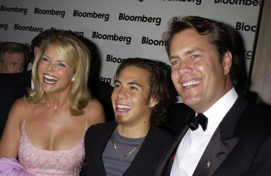 Christie Brinkley, Apolo Anton Ohno, and Peter Cook, pictured in 2002. (Photo by Theo Wargo/WireImage) Photo: Theo Wargo, Getty Images / WireImage