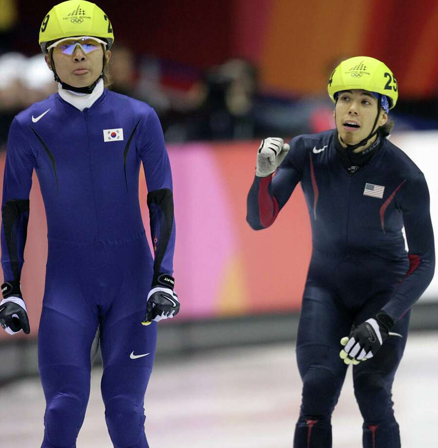 Apollo Ohno and South Korea's Hyun-Soo Ahn react after the Men's 1000 m semifinal during the short track competition at the 2006 Winter Olympics, on Feb. 18, 2006 at the Palavela in Turin. Photo: GOH CHAI HIN, Getty Images / 2006 AFP