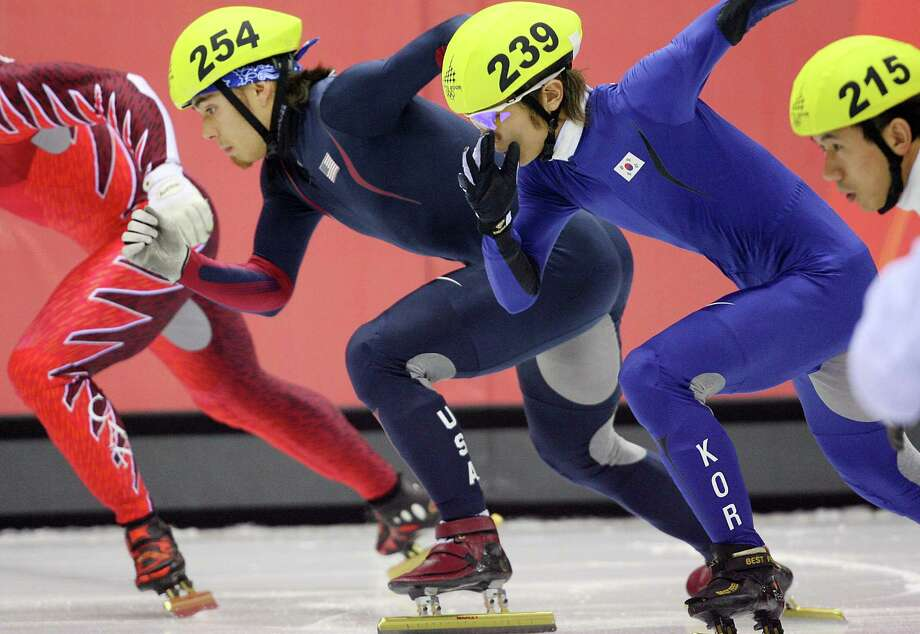Apollo Ohno, South Korea's Hyun-Soo Ahn and China's Li Jiajun take the start of the Men's 1000 m semifinal during the short track competition at the 2006 Winter Olympics, on Feb. 18, 2006 at the Palavela in Turin. Photo: YURI KADOBNOV, Getty Images / 2006 AFP