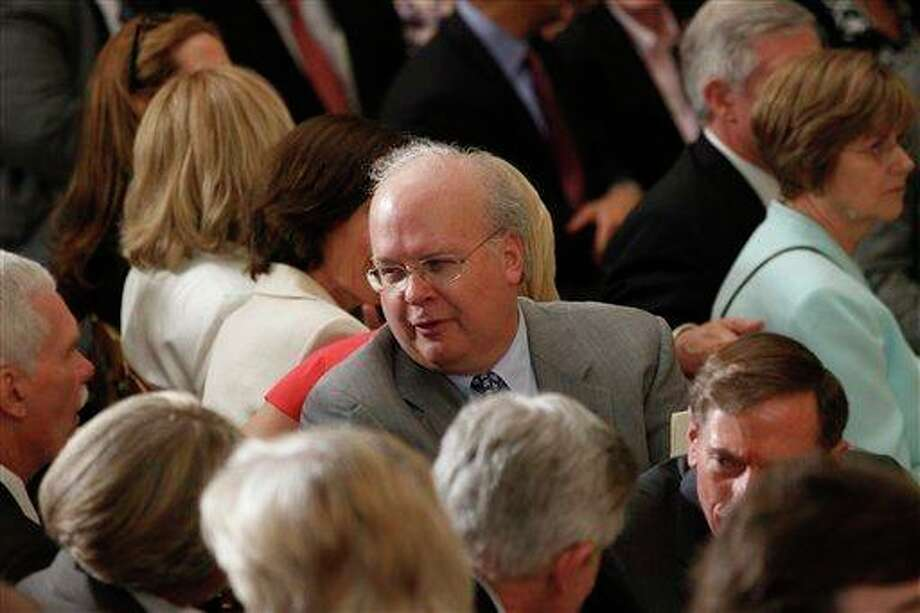 Former White House adviser Karl Rove is seated before the unveiling of the official portraits of former President George W. Bush and former first lady Laura Bush in the East Room at the White House in Washington, Thursday, May 31, 2012. (AP Photo/Charles Dharapak) Photo: Charles Dharapak, AP / AP