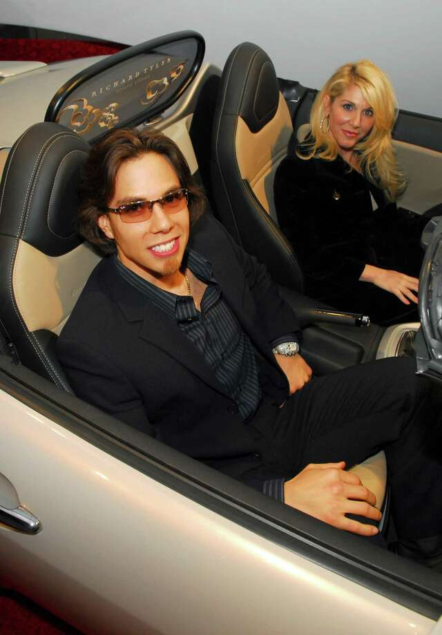 Apolo Anton Ohno and guest with 2007 Saturn Sky. (Photo by M. Caulfield/WireImage for InStyle Magazine) Photo: Michael Caulfield Archive, Getty Images / WireImage