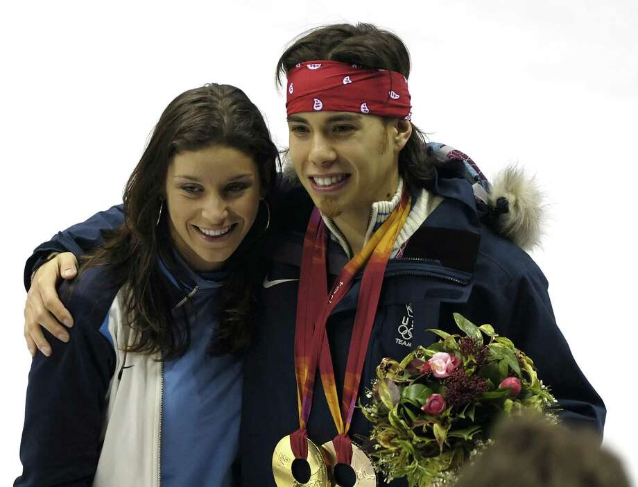 Apolo Anton Ohno's teammate, speedskater Allison Baver enjoys the moment with Ohno during the Short Track Speed Skating 500 m at the 2006 Olympic Games held at the Palavela in Torino, Italy on Feb. 25, 2006. (Photo by S. Levin/WireImage) Photo: S. Levin, Getty Images / WireImage