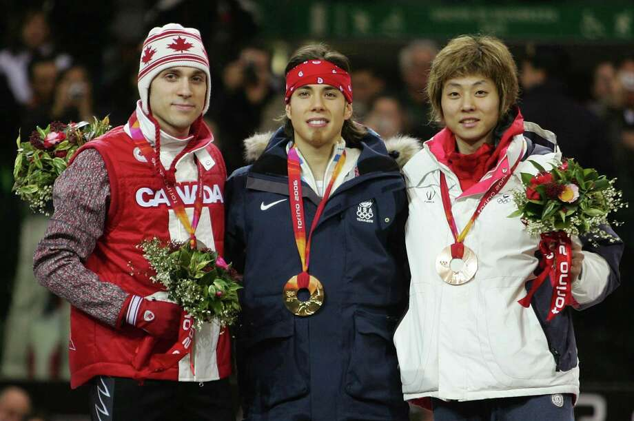 Francois-Louis Tremblay of Canada, Apolo Anton Ohno and Hyun-Soo Ahn of Korea acknowledge the crowd after winning silver, gold and bronze respectively in the 500 meter final of Short Track Speed Skating on Day 15 of the Turin 2006 Winter Olympic Games on Feb. 25, 2006 at Palavela in Turin, Italy. Photo: Al Bello, Getty Images / 2006 Getty Images