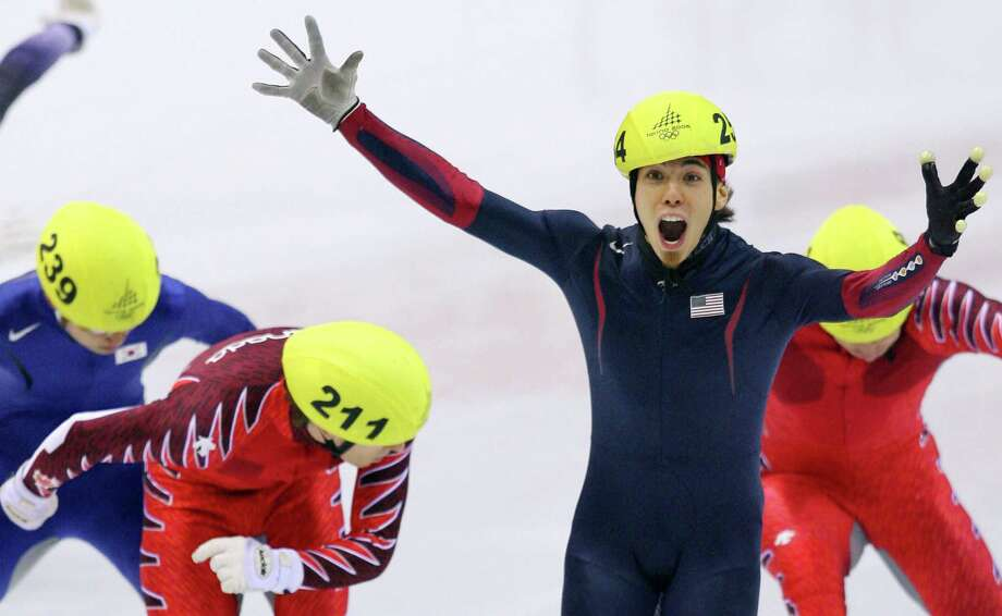 Apollo Ohno celebrates winning the gold medal of the men's 500m race of the short track competition at the 2006 Winter Olympics, on Feb. 25, 2006 at the Palavela in Turin. Photo: YURI KADOBNOV, Getty Images / 2006 AFP