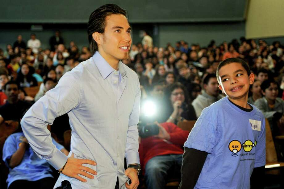 Apolo Anton Ohno participates in a video game with students at Robert Wagner Middle School on March 4, 2010 in New York City. Photo: Rob Loud, Getty Images / 2010 Getty Images