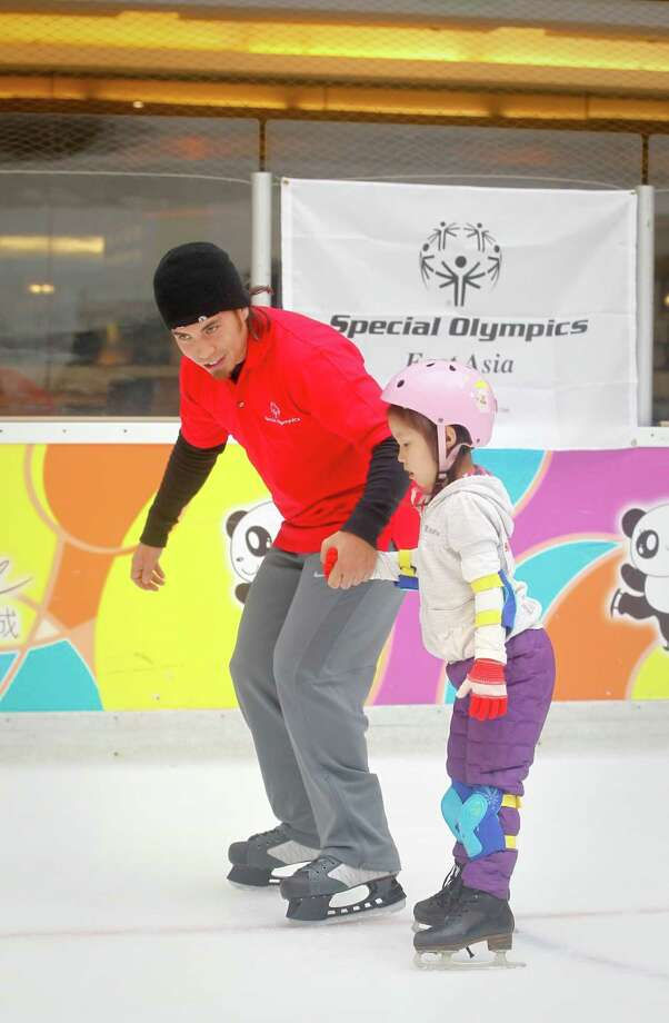 Olympic gold medalist Apolo Anton Ohno as a global ambassador for the Special Olympics attends a training session with teenagers at China World Mall during his Asia trip on Feb. 13, 2012 in Beijing, China. Photo: ChinaFotoPress, Getty Images / 2012 ChinaFotoPress