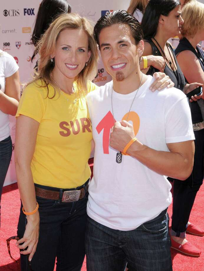 "Marlee Matlin and Apolo Anton Ohno arrive at the ""Stand Up To Cancer"" fundraising event aimed at raising funds to accelerate innovative cancer research for patients held at Sony Studios on Sept. 10, 2010 in Culver City, Calif.  (Photo by Gregg DeGuire/FilmMagic) Photo: Gregg DeGuire, Getty Images / 2010 Gregg DeGuire"