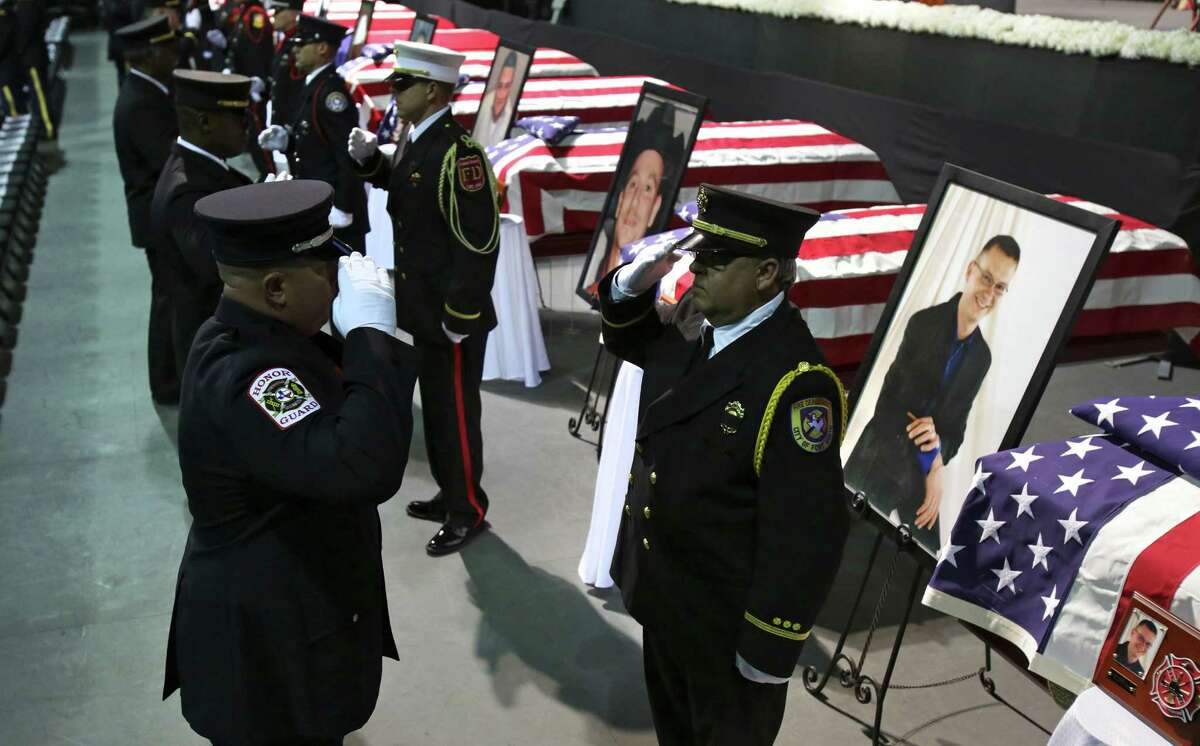 Fire Department Honor Guard from around the country rotate out as they stand next to coffins of the fire fighters that were killed in the West, TX explosion, on Thursday April 25, 2013 at the Ferrell Center at Baylor University, where President Obama is scheduled to speak.