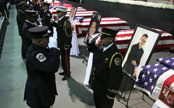 Fire Department Honor Guard from around the country rotate out as they stand next to coffins of the fire fighters that were killed in the West, TX explosion, on Thursday April 25, 2013 at the Ferrell Center at Baylor University, where President Obama is scheduled to speak. Photo: Bob Owen, San Antonio Express-News / ©2013 San Antonio Express-News