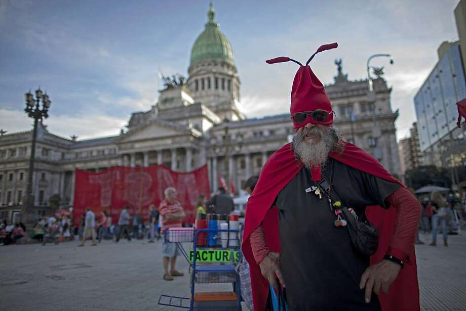 Don't crawl for me, Argentina: A retiree dressed as an ant protests judicial reform proposed by President Cristina Fernandez outside Congress in Buenos Aires. Photo: Natacha Pisarenko, Associated Press