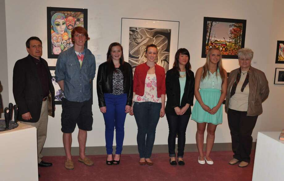 At left, Joel Chapin, Fulton Montgomery Community College fine arts professor and director of the school's Perrella art gallery, stands with student-artists honored at the school's 22nd annual Regional High School Exhibition. From left are Henry Caughey, Ashley Hinch, Katherine Love, Herin Park, Nicole Little, and juror Kathryn Zajicek. (AMY RADIK)