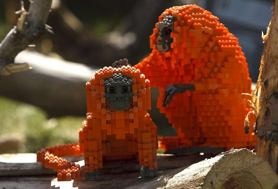 Rhesus pieces: A Lego monkey grooms a young plastic simian at the Hogle Zoo in Salt Lake City. Lego artist Kenney (just Kenney) used more than 125,000 Lego pieces to build 30 animals on display at the zoo. He's hoping to draw attention to the plight of endangered species. Photo: Leah Hogsten, Associated Press