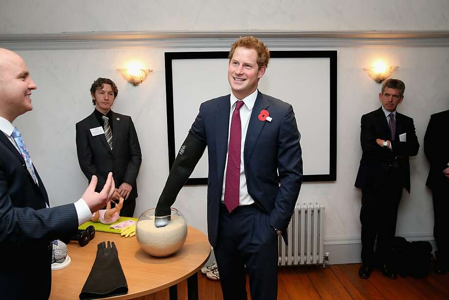 Am I getting warmer? To understand of what it's like to live with a brain injury, Prince Harry wears a glove while trying to identify an object hidden in a bowl of rice during a visit to the Headway charity at Bradbury House in Nottingham, England. Headway helps people who have suffered brain trauma. Photo: Chris Jackson, Getty Images