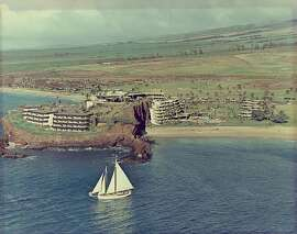 The land around the Sheraton Maui has been significantly altered since this undated photo was taken, but the sea and the cliffs of Black Rock, called Pu'u Keka'a in Hawaiian, look the same today.