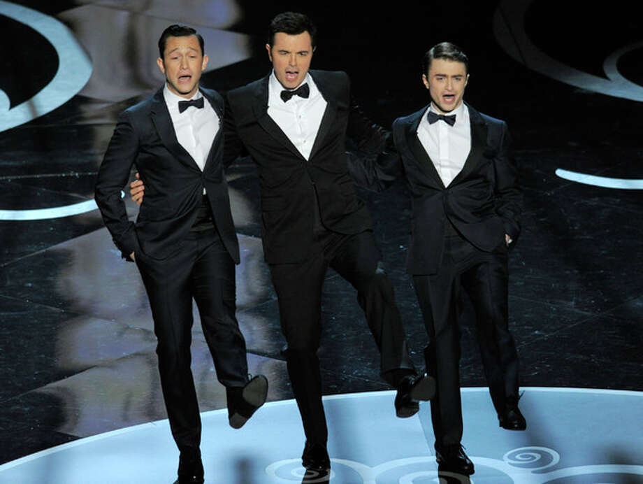 Joseph Gordon-Levitt dancing during the opening number at this year's Oscar ceremony, with host Seth MacFarlane and Daniel Radcliffe