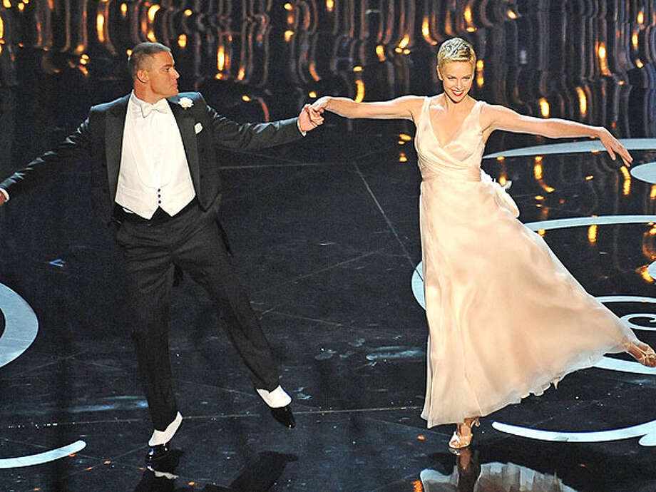 Channing Tatum dancing with Charlize Theron during the opening number at this year's Oscar ceremony Photo: ROBYN BECK / 2013 AFP