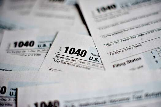 25. Taxes: If you are coming from outside Texas borders, you'll be happy to hear that we don't have a state income tax. Houston also ranks among the places with the lowest total tax burden.  Photo: Daniel Acker/Bloomberg