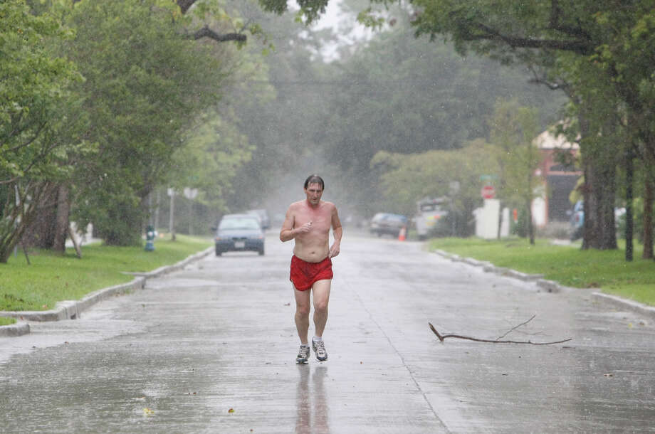 A runner braved Houston rain last week. The following photos show the last big downpour, which brought flooding nearly two weeks ago on a Saturday.