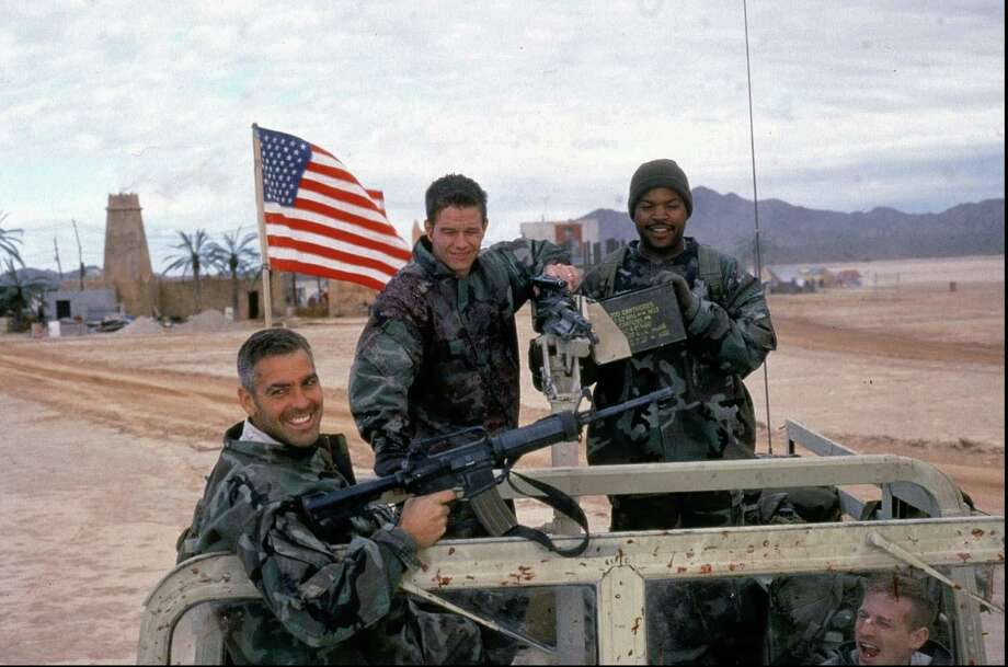 (GANNETT PHOTO NETWORK) MOV-KINGS:  George Clooney, left to right,  Mark Wahlberg and Ice Cube in a scene from 'Three Kings.' (GNS Photo) Photo: MURRAY CLOSE / WARNER BROS.