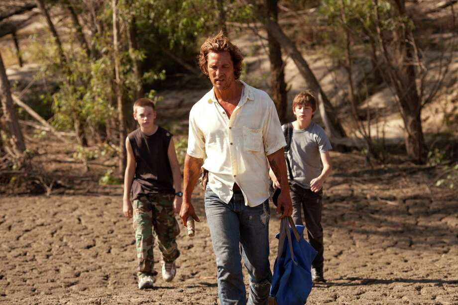 Jacob Lofland (left), Matthew McConaughey (middle) and Tye Sheridan (right) star in Jeff Nichols' MUD, in theaters April 26th. Photo Credit: James Bridges/Roadside Attractions Photo: Jim Bridges